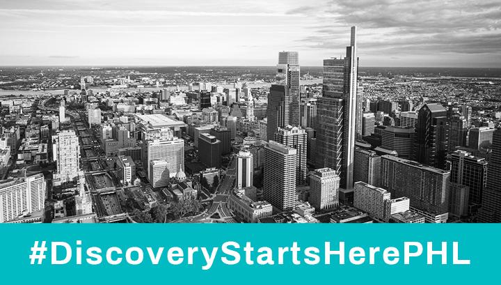 Black & white bird's eye view photograph of Philadelphia with #DiscoveryStartsHerePHL text underneath
