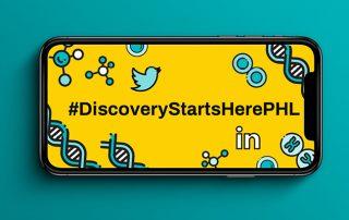 Horizontal phone with animated image on screen stating: #DiscoveryStartsHerePHL